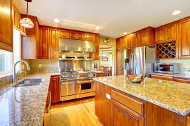 wood luxury kitchen with light granite counters