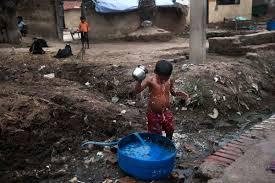 slow poison arindam mukherjee magazine a child bathing by the side of a street at joana village in jajmau waste water pollution is a big problem in jajmau area