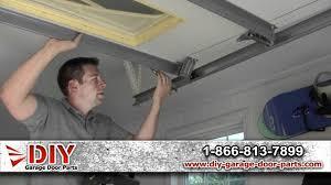 how to install garage door rollers