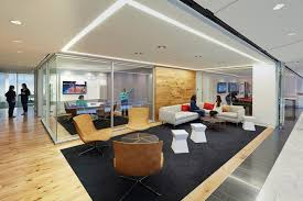 office seating area. To Visually Connect The Space: Starting With Transaction Top Of Reception Desk (with Integrated Back Lit Logo), Wall In Seating Area, Office Area