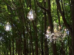 et rigged chandeliers metal glass lanterns in the woods for wedding cocktail reception