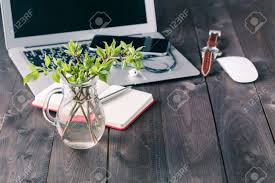 top office table cup. Top View Office Desk Mockup: Laptop, Flower, And Cup Of Tea On Rustic Table O