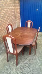 dark wood dining table and 4 chairs jpg