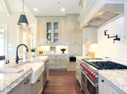 white country kitchen country style galley kitchen with white cabinets farmhouse sink and subzero wolf range