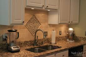 backsplash ideas for kitchen with white kitchen cabinet and cream backsplash made of marble in