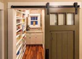 turn that old door into a sliding barn style door for the pantry design