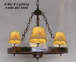 ww025 24 3 rustic wagon wheel chandelier light fixture with 3 adjule uplights shown with rawhide shades sold separately