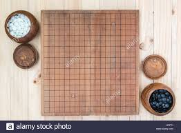 Game With Stones And Wooden Board top view two wooden bowls filled black and white stones with empty 29