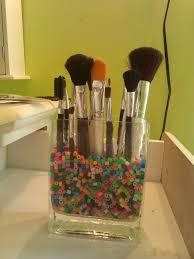 brush holder beads. make a home made makeup brush holder super easy and cheap. just take an old vase or container poor i small beads put in your brushes. e