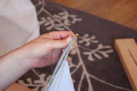 add approximately 2 on each side of the pleat and pin together that accounts for your total of 8 per pleat as mentioned earlier