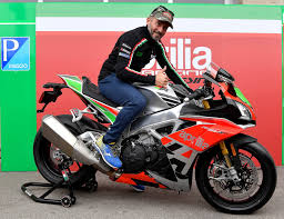 the chion max biaggi on the saddle of the new aprilia rsv4 rf limited edition