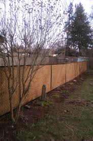 this is the long view of my solution to an ugly chain link view privacy lattice framed with aluminum j channel spray painted it black j chann