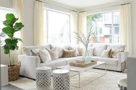 Off White Sectional With Pink And Gray Pillows