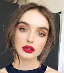 the holidays calls for a festive red lipstick along with light and neutral eyes go brighter and bolder with a super pigmented red like pat mcgrath labs