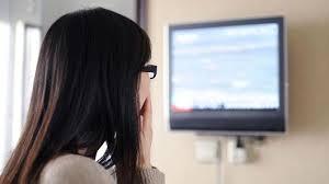 black kids watching tv. young girl watching tv black kids