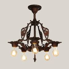 antique spanish revival chandelier with shields overall antique spanish revival chandelier with shields lit