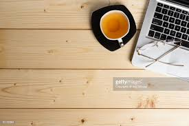 Top office table cup Stock Wooden Office Table Top View With Green Tea Cup Computer Keyboard And Spectacle Stock Getty Images Wooden Office Table Top View With Green Tea Cup Computer Keyboard