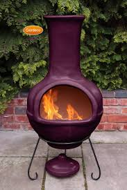 clay chiminea fireplace in purple with black iron stand for outdoor furniture ideas