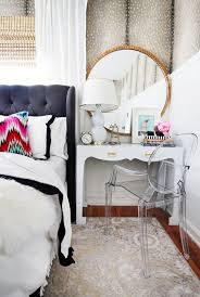 chic bedroom featuring a chic side table vanity with a lucite chair and gilded mirror bedroomalluring members mark leather executive chair