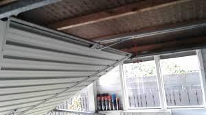 tilt garage door with newly installed merlin garage door opener you