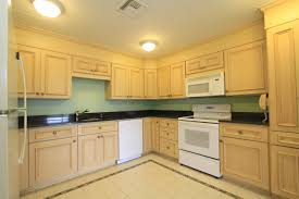 natural simple interior kitchen design with maple cabinets in white kitchen and also cream modern floor