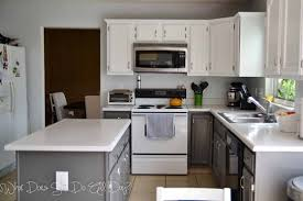 gray and white painted kitchen cabinets with white countertop