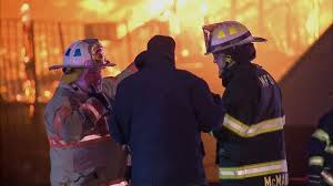 Firefighters struggle to battle blazes in brutally cold temperatures ...