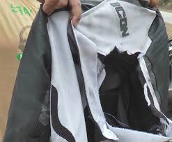 a photograph showing an icon mesh leather jacket that was torn apart at the chest area
