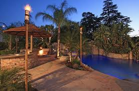 lighting tiki torches. View In Gallery Complement That Outdoor Fireplace With Some Elegant Tiki Torches Lighting K