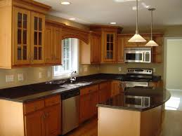 ... Contemporary Kitchen Design With L Shaped Natural Brown Finish Oak  Kitchen Island Using Black Granite Countertop ...