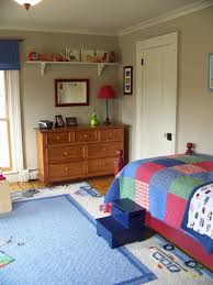 Small Bedroom Chest Of Drawers Blue White Car Carpet On The Floor And Red Table Lamp On Brown