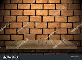 empty top wooden shelves and brick wall background for montage or display products