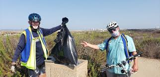 Ivan Dunn and Frank Spitzer with trash from trail | Coronado Times