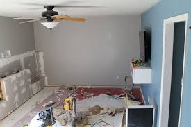the plan was to replace the ceiling fan with six recessed lights to evenly dis light throughout the entire room and visually de clutter and heighten