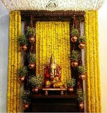 ganapati decoration ideas at home with marigold flowers image source