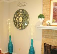 pier one carved scroll wall decor  and teal peacock floor vases