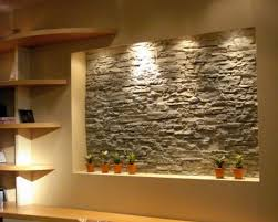 prestigious center wall of free space decorated with glorious stone wall interior which is enlightened by wall lamp installed near with wall shelves x