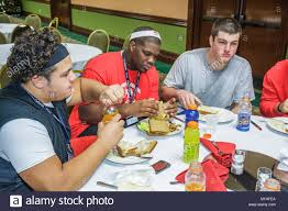 high school lunch table. Lunch All American Offense Defense Bowl High School Football Players Athletes Food Eat Table Black Teen Teenager Male O