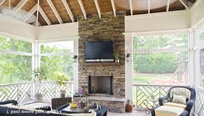 exposed white rafters along with stone fireplace screened in deck ideas c75
