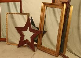 item 554 large grouping of mirrors incl hanging mirror in white frame with beveled glass star shaped mirror some hanging mirrors having carved