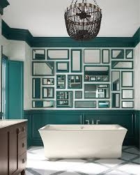 art deco bathroom. art deco master bathroom with crown molding, freestanding bathtub, flush, wainscoting,