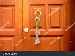old style wooden door with handle in spanish city