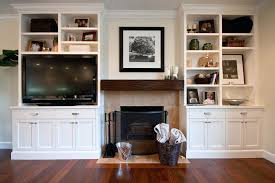 tv fireplace cabinets charming built in bookshelves around floating shelves around white shelves and above fireplace
