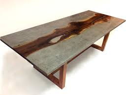 i design and build custom furniture mostly dining tables here is my latest creation concrete and live edge black walnut dining table