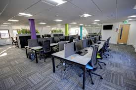 office desing. Commercial Office Design With Multicoloured Pillars And Distressed Marble Desks Desing