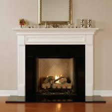 standard height for a fireplace mantel a square mirror with gold tone frame some small metal