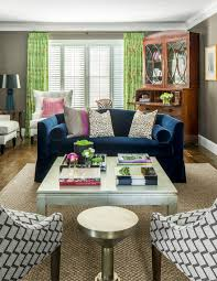 a blue ferrell mittman loveseat settles the room opposite two schumacher chairs wearing pierre frey fabric additional seating finds a place with custom