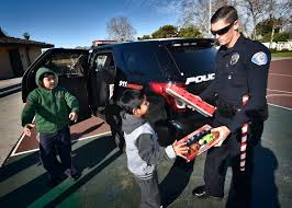 garden grove pd garden grove pd officer john hands out donated presents to kids on morning