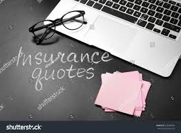 text insurance quotes laptop and gl on blackboard background