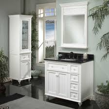 white wooden vanity with black glossy top and white sink on ceramics